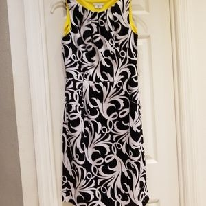 Black and white sleeveles dress